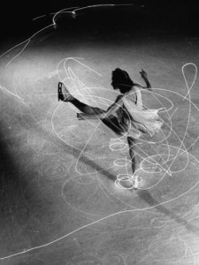 gjon-mili-figure-skater-carol-lynne-with-flashlights-embedded-in-her-skates